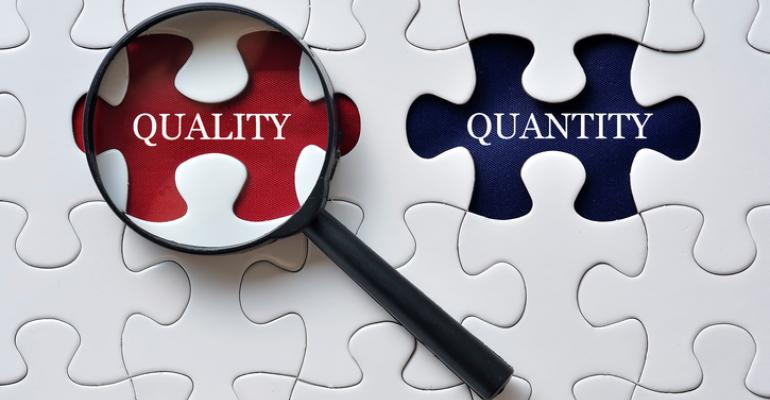 """Magnifing glass on missing puzzle piece that says """"quality"""""""