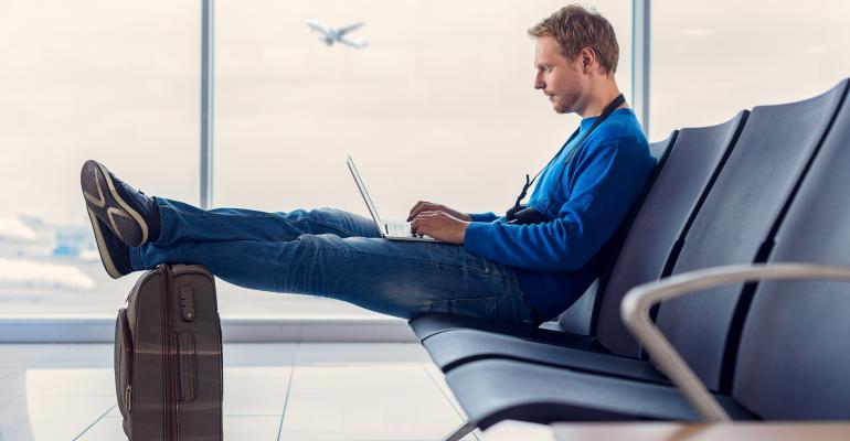 airline passenger awaits boarding