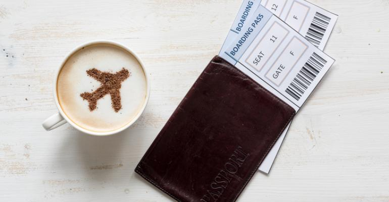 Capuccino cup with boarding passes