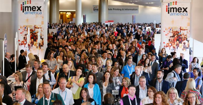 The crowd surges onto the show floor on opening day of IMEX America 2016