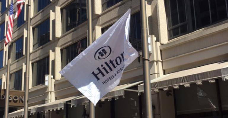 Team Members join General Manager Paolo Pedrazzini to raise the Hilton flag and welcome The Madison Washington DC, a Hilton Hotel to the portfolio of 14 brands.