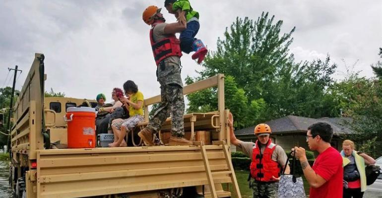 Texas Guardsmen evacuate Houston residents after Hurricane Harvey.