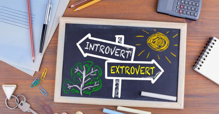 "Signs reading ""introvert"" and ""extrovert"""