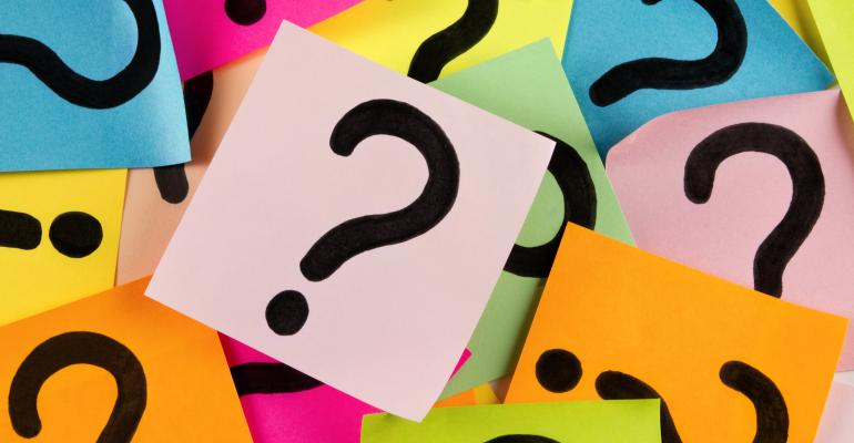 Question marks on PostIt notes