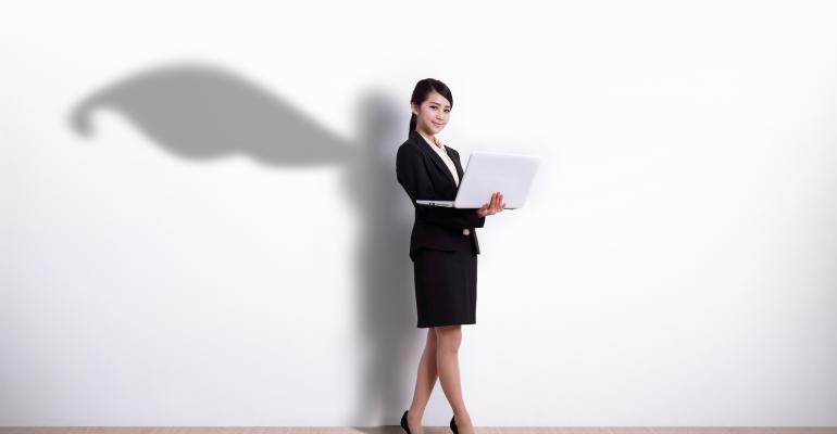 Superhero business woman using laptop computer with white wall background, great for your design or text