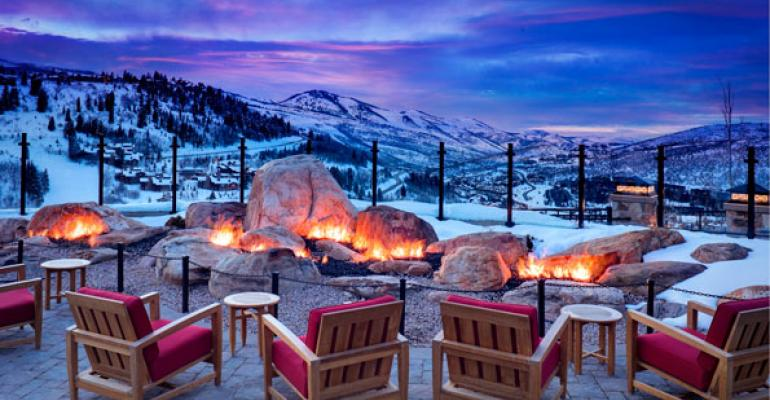 Mountain Terrace at St Regis Deer Valley guests can warm themselves at the fire pit while catching spectacular Wasatch Mountain views