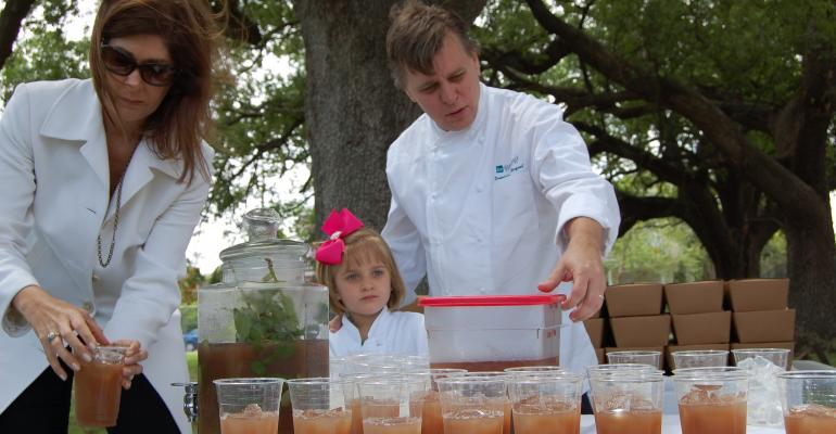 New Orleans chef Dominique Macquet serving mintinfused iced tea with his wife Wendy and daughter Nadya at a local event will be one of the experts participating in the Morial39s Farm to Table symposium