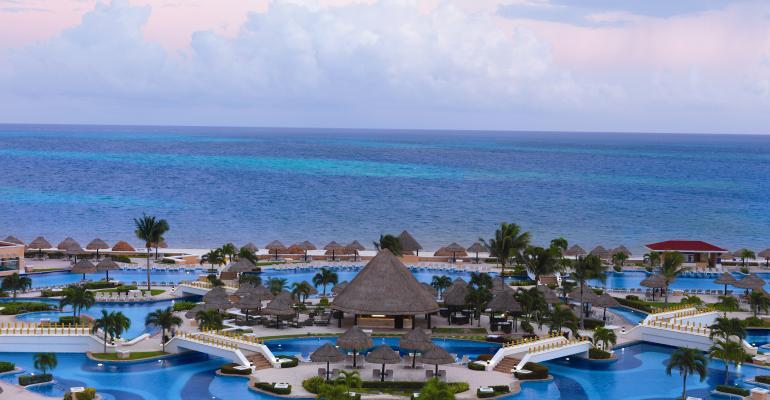 The beachfront pool at Moon Palace Golf and Spa Resort