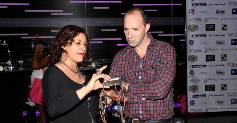 Emmy winner Tony Hale from HBOs Veep looking at jewelry made by one of CHA39s sponsors at the 2013 Emmy Awards