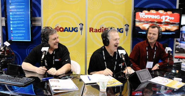 OAUGrsquos radio hosts Lee Kantor left and Stone Payton center have some fun with a guest in the RadiOAUG booth during COLLABORATE 13