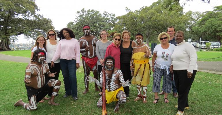 After arriving in Sydney participants were welcomed with a performance by the aboriginal dance company Descendance at the scenic city park Mrs Macquariersquos Chair With the dancers from left Samantha Holmes North America Tourism Australia Andrea HenningBeavon CMP Down to the Details Bayo Sharp HelmsBriscoe Danielle Childress CPI Regina Baraban MeetingsNet Cindy LoPatriello VIP Incentives Christianne Heba Meetings Unlimited Steven Dixon Tourism New Zealand and Gwendolyn Moore Ford Motor Co
