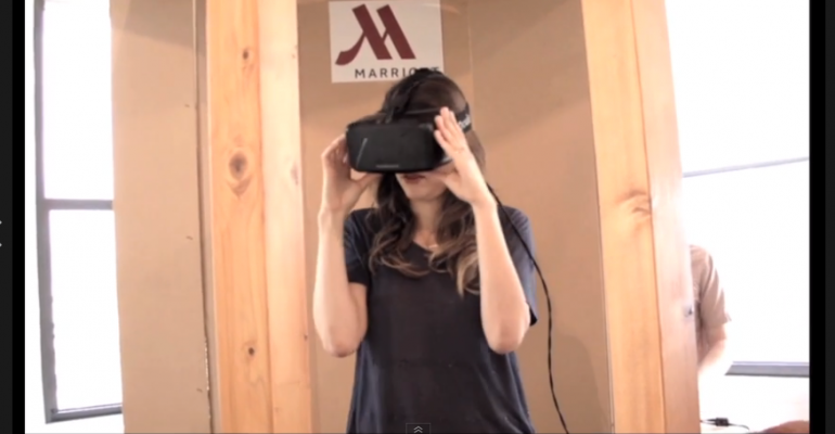 Person donning Oculus Rift as part of the Marriott Hotels39 Transporter 4D immersive virtual travel experience