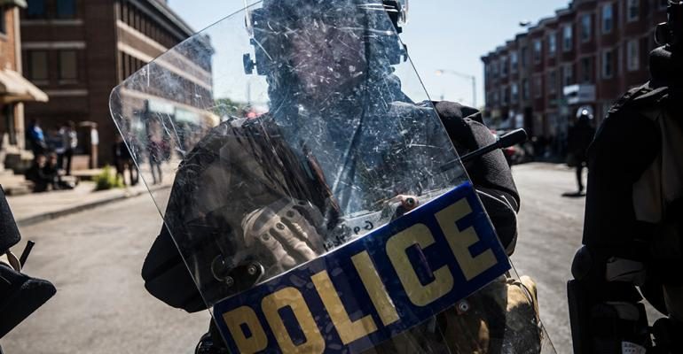 Baltimore Riots Drive Meeting Cancellations