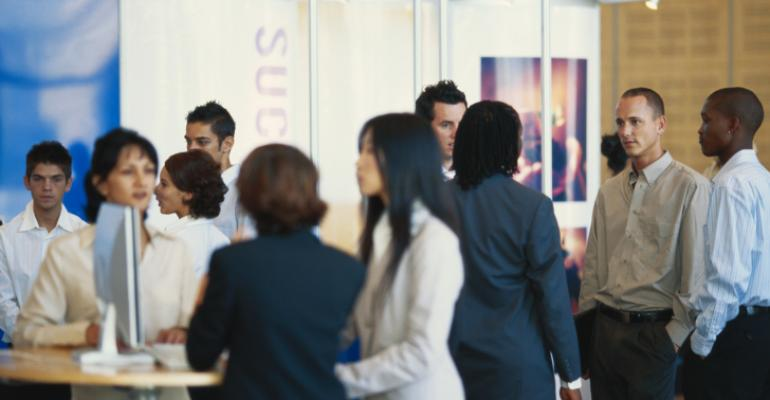 Young exhibitors mingle at a tradeshow