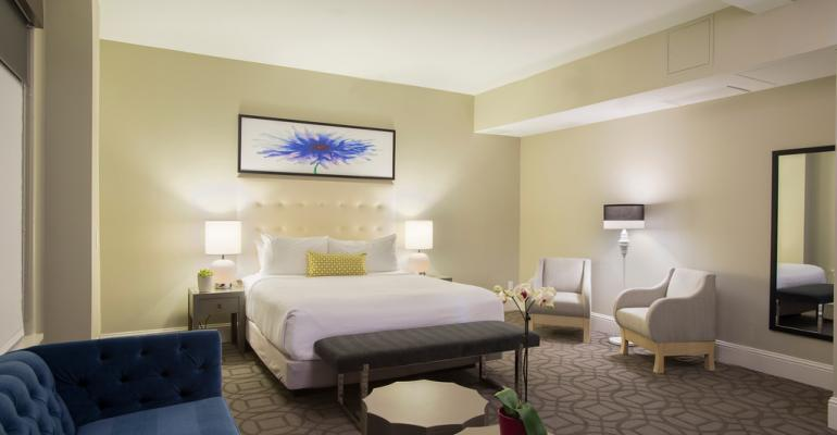 Premier king guest room at the Magnolia Hotel Denver