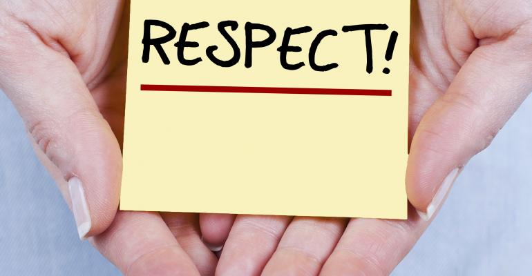 Hands holding PostIt saying Respect