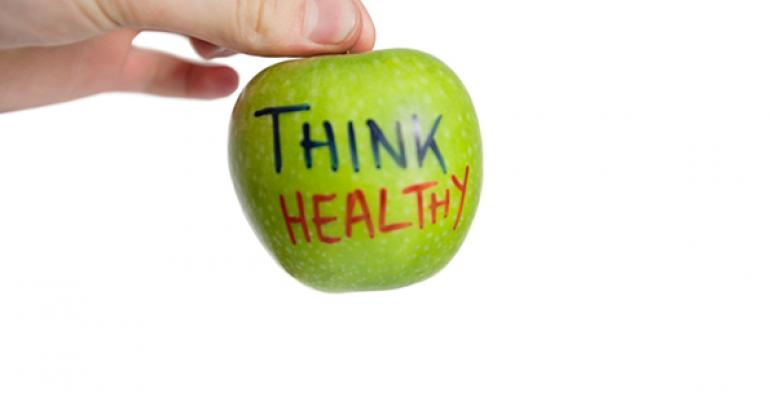 Hand holding apple with think healthy written on it