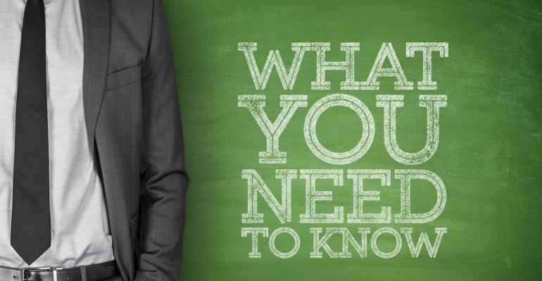 Man next to chalkboard message what you need to know