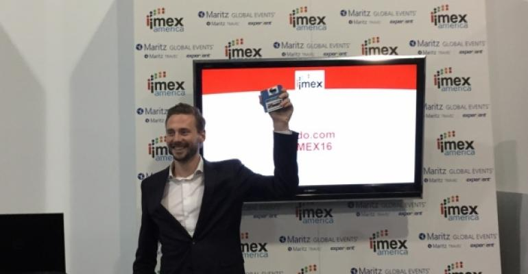 Tim Groot of Grip holding IMEXpitch prize