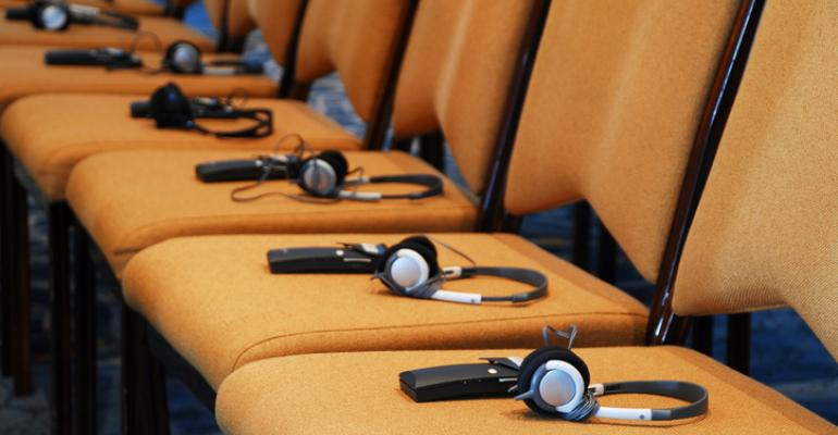 Translation headsets on row of chairs