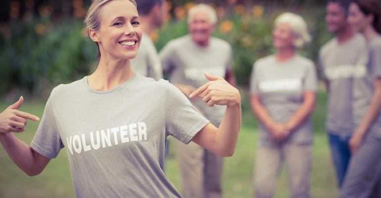 A volunteer shows off her t-shirt