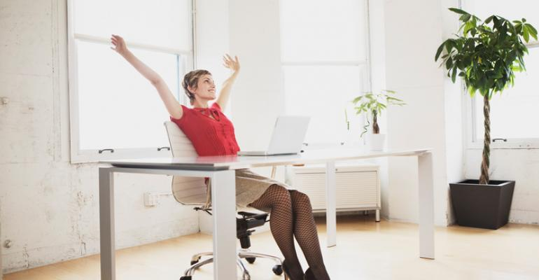Woman at desk stretching