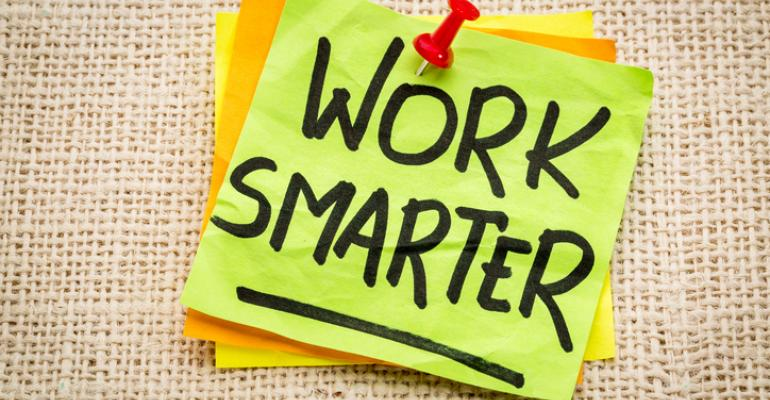"""Post-It note saying """"Work Smarter"""""""