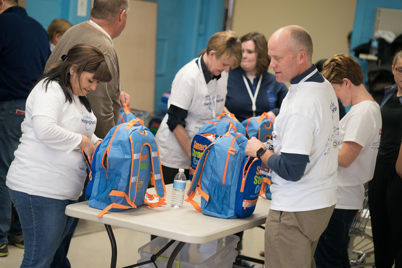 PCMA volunteers fill school backpacks