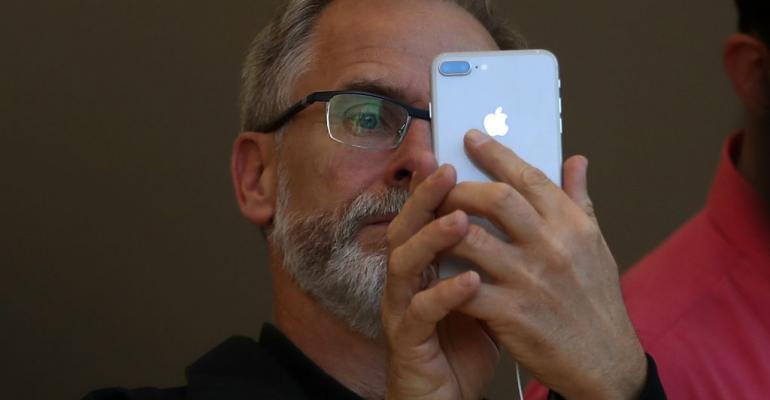 Guy holding iPhone