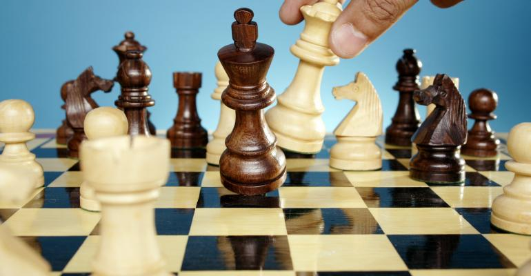 Man playing chess game - Checkmated
