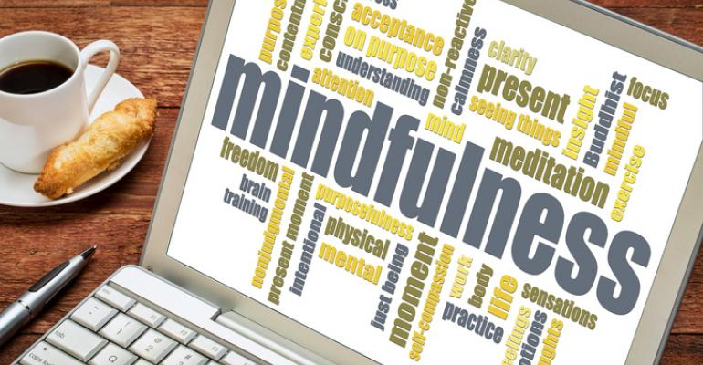 Mindfulness word cloud on laptop