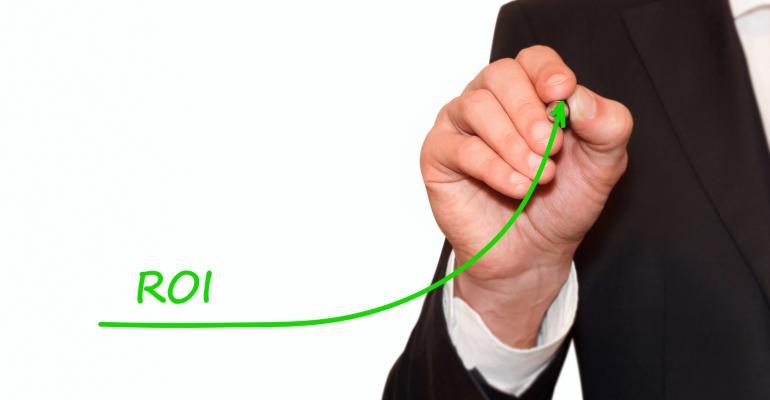 Business man hand drawing an increase line on ROI