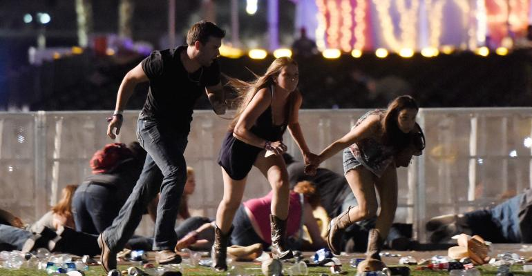 People run from gun fire at a Las Vegas country music festival
