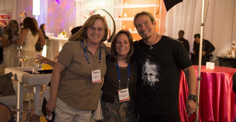 Left to right Cathie Myers and Shelly Sichta with Best Friends Animal Society share a moment with opening general session speaker artist and author Eric Wahl