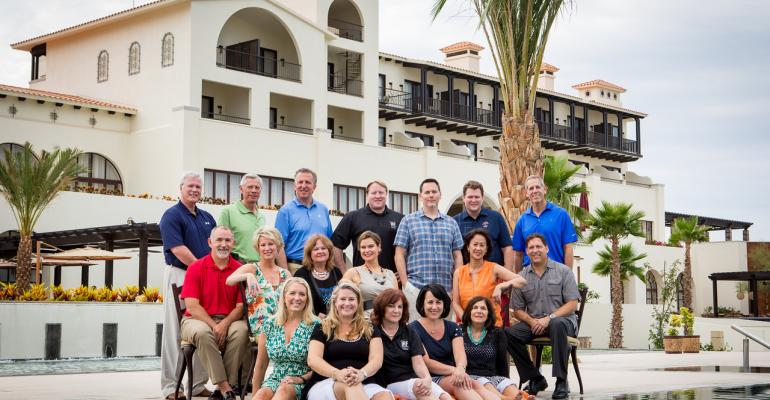 The IRF board of trustees with the Secrets Puerto Los Cabos host property in the background were ready to welcome this year39s Invitational participants