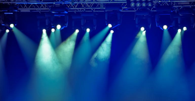Spotlights on a hazy stage