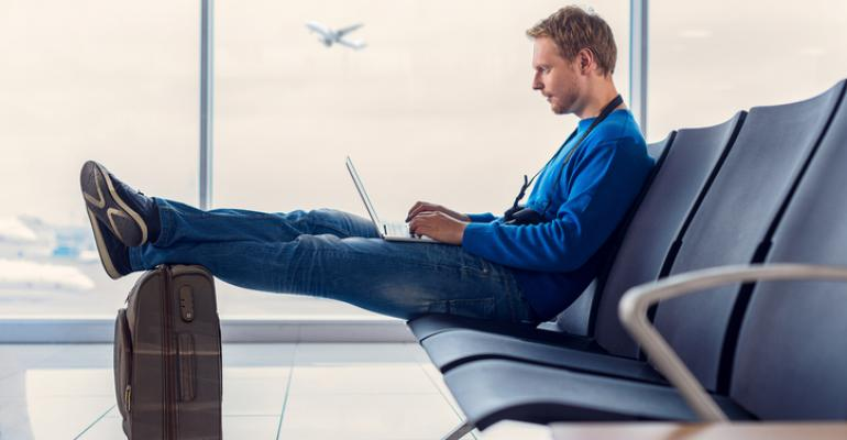 Man using a laptop at the airport