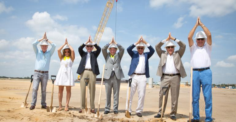 Margaritaville execs raise their fins at the groundbreaking of the new Orlando resort