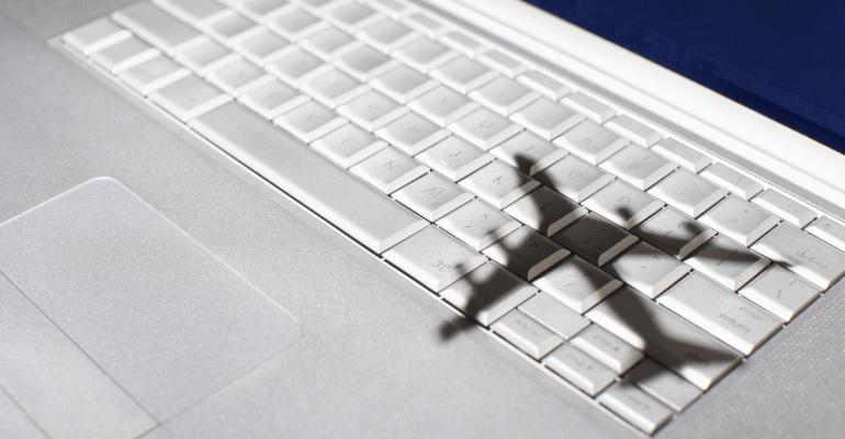 airplane shadow on laptop keyboard