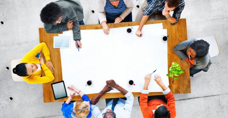 People sitting around a table at a meeting