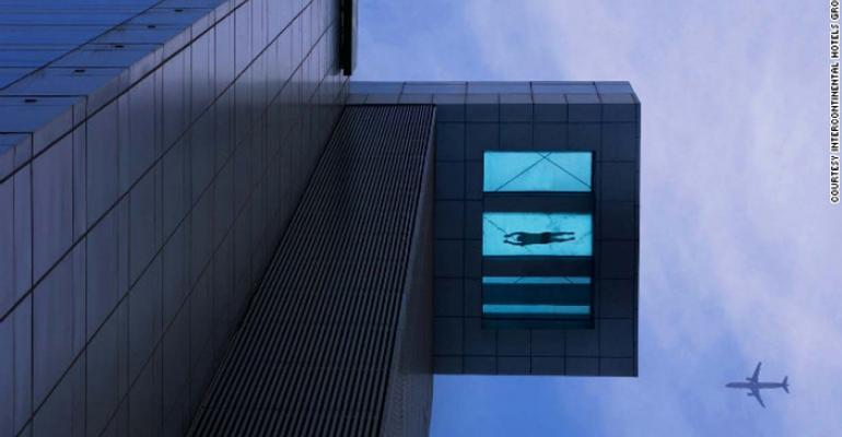 Glass-bottomed high-rise swimming pool–yikes!