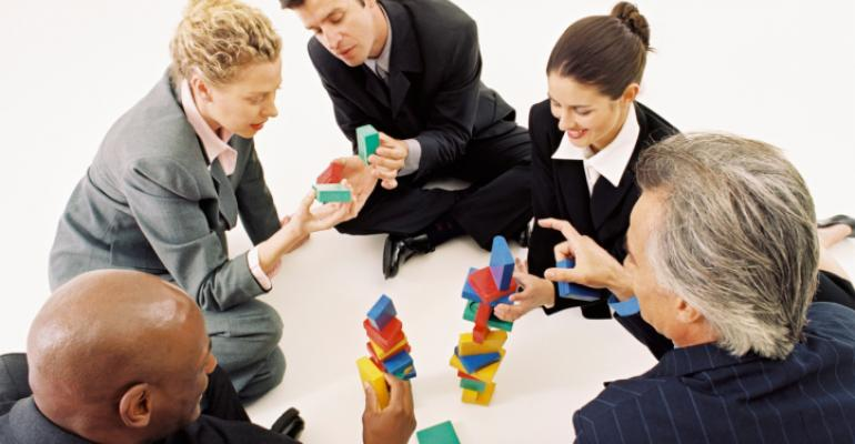 business people playing with blocks