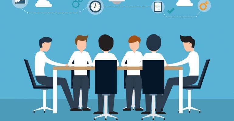 People sitting at table brainstorming