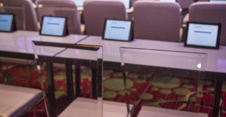 hotel ballroom with ipads at each seat